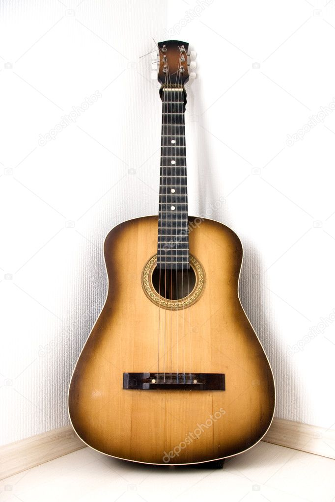 depositphotos_1652089-stock-photo-guitar-in-a-corner-of